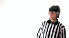 Hockey referee shows head attack - stock footage