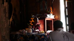 Monk with congregation in Buddhistic monastery - stock footage