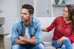 Woman consoling man after argument Stock Photos