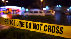 Police Investigation After A Shooting Crime Scene Tape Close Up Stock Footage
