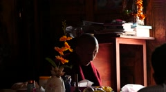 Monk with congregation in Buddhistic monastery in Myanmar closeup - stock footage
