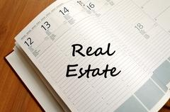 Real estate write on notebook Stock Photos