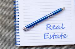 Real estate write on notebook - stock photo