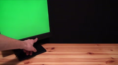 Hand off computer with green screen, chroma Stock Footage
