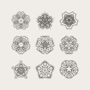 Stock Illustration of Set of ornate vector mandala symbols. Gothic lace tattoo. Celtic weave with
