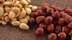 Almonds, cashew, walnuts and hazelnuts lying on burlap - stock footage