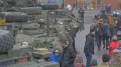 People Walking Along Parked Military Vehicles Nato Operation in Opole Poland Stock Footage