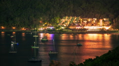 4K TimeLapse. Night view of the floating yachts and glowing hotel on the slope Stock Footage