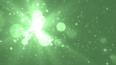 Moving gloss particles on green background. - stock footage