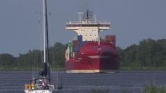 Contianership passing Kiel Kanal Germany Stock Footage