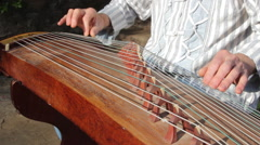 Man is playing the Guzheng-chineese harp - stock footage