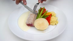 Person eating Tuna Steak Gourmet cuisine food with cream gravy sauce Stock Footage