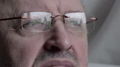 Man in glasses looks at the temple Stock Footage