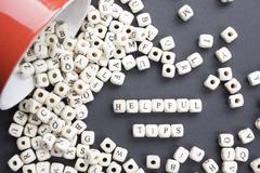 Helpful Tips  word written on wood block. Wooden ABC - stock photo