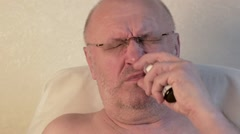 a man with a runny nose sprays a spray in the nose - stock footage