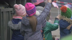Kids Waving a Paper us Flags Excursion Military Camp Nato Forses at the City Stock Footage