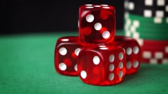 Red dice, casino chips, cards rotation on green felt Stock Footage