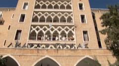 Nicosia Cyprus Green Line - tilt down Ledra Palace UN HQ facade Stock Footage