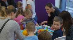 Kids Educators at Children's Day in Library Opole Poland Kids Are Painting Stock Footage