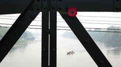 Kwai river bridge with poppy & boat Stock Footage