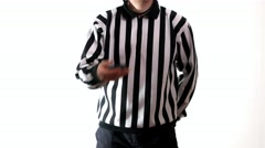 playing hockey referee demonstrate hockey puck - stock footage