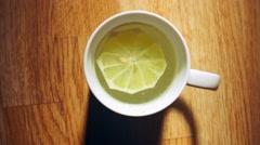 Hot lemon tea, good source of vitamin C Stock Footage