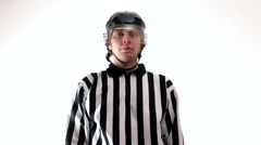 Hockey referee hold a puck in his palm - stock footage