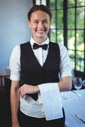 Waitress posing with crossed arms - stock photo