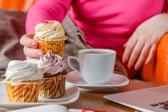 Woman drink tea and eat sweets Stock Photos