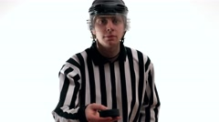 hockey referee referee demonstrate hockey puck - stock footage