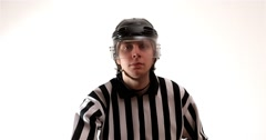 Hockey referee holding a puck in face off position - stock footage