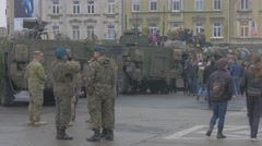 Nato Operation Opole Soldiers Are Standing and Talking People Walking by Parked Stock Footage
