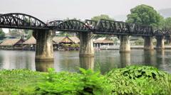 Kwai river bridge, Kanchanaburi wide view from river bank Stock Footage