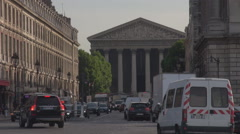 Car traffic in Paris, La Madeleine church, Concorde nearby, monument, landmark Stock Footage