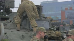 Soldiers Nato Operation Opole Men in Camouflage Putting an Equipment Into Hatch Stock Footage