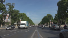 Paris city car traffic, driving on Champs Elysees famous avenue, downtown motion Stock Footage