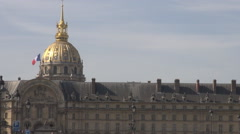 Paris landmark Les Invalides dome, France national flag waving, blue sky, symbol Stock Footage