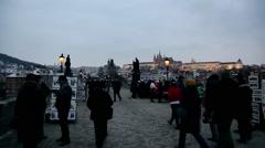 PRAGUE, CZECH REPUBLIC: Tourists walking on Charles bridge in January - stock footage