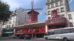 Paris attraction Moulin Rouge, Red Mill, amusement bar, french landmark daylight Stock Footage