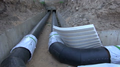 Plastic black central heating pipes Stock Footage