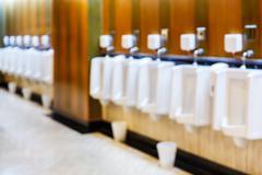Blur urinals in gentlemen restroom Stock Photos
