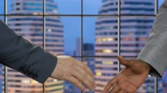 Business handshake on night city background. Stock Footage