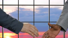 Business handshake on sunset background. Stock Footage