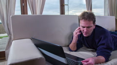 Stock Video Footage of A man is calling regarding an issue with his credit card