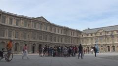 Louvre courtyard, Paris museum landmark, tourists visit France, old building - stock footage