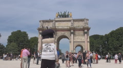 Paris carousel, Tuileries garden entrance, monument gate Parisian people, summer Stock Footage