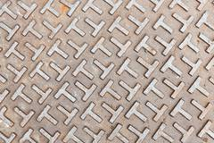 Steel sewer lid texture - stock photo