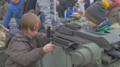 Kid Looking Through Periscope Playing Nato Operation in Opole Poland Soldiers Stock Footage