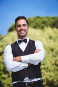 Handsome waiter smiling at camera Stock Photos