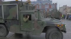 Nato Vehicles Driven Around a Sqare Soldiers Waving Hands Nato Training in Stock Footage